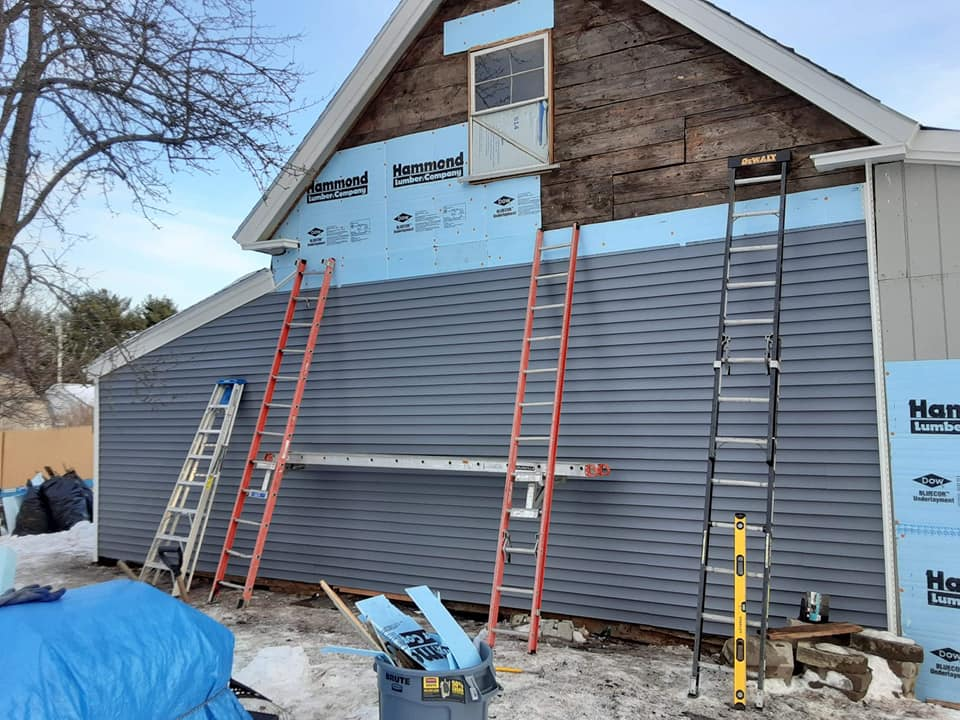 Durable vinyl siding installation in process